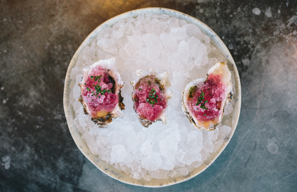 Kumamoto oysters with pickled red onion ice.