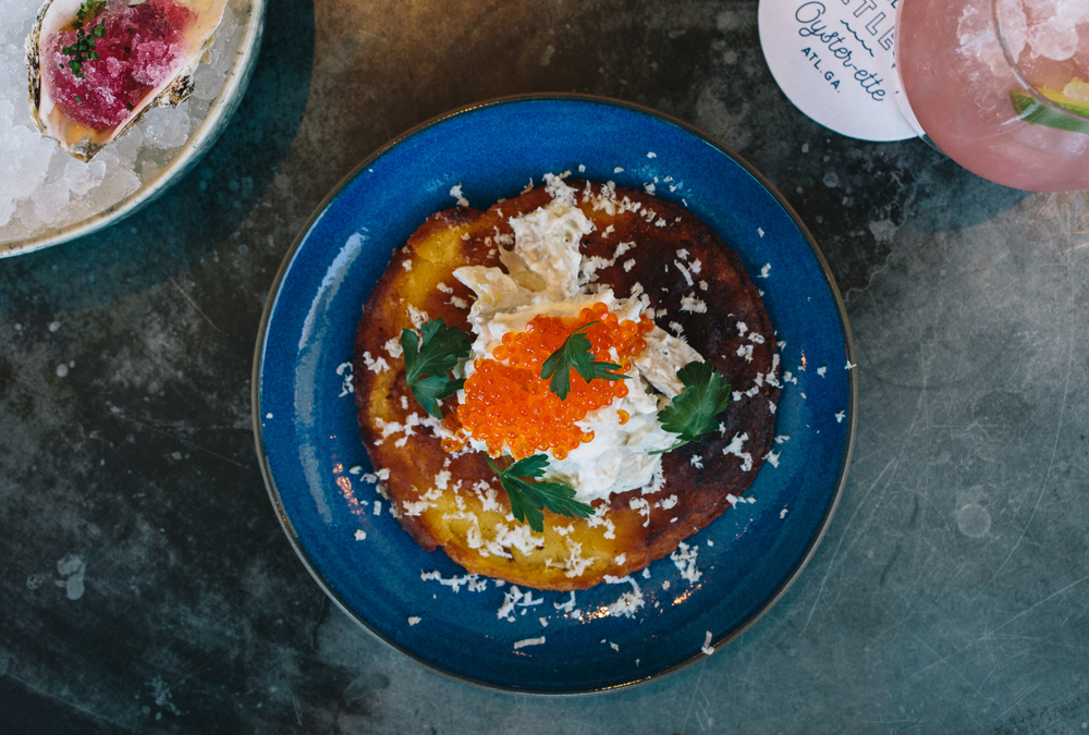 Johnny cake with smoked trout, crème fraiche, roe and horseradish.