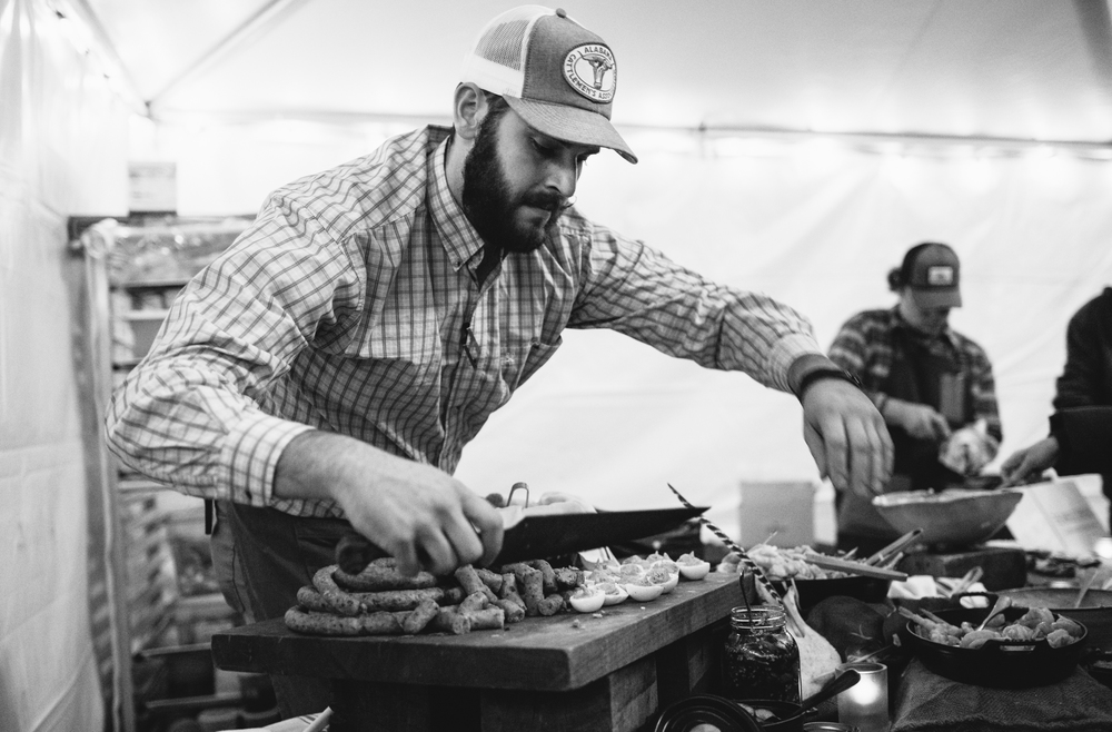 Acre's Chef de Cuisine Caleb Fischer divvying out a spread that included shrimp, octopus and deviled eggs.