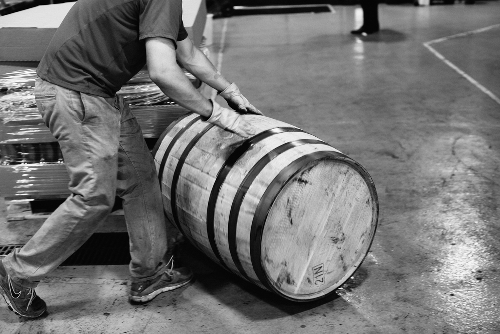 Rolling a whiskey barrel across the facility.