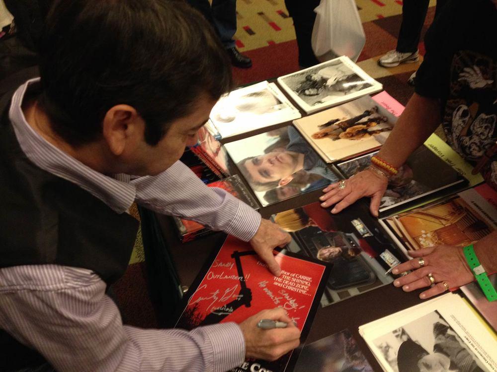 John-signing.jpg