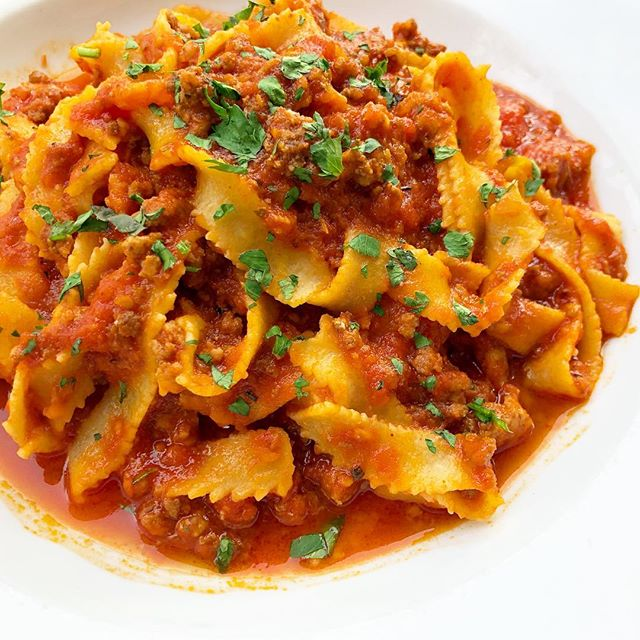 Tagliatelle Bolognese . . . House made flat noodles with delicious meat sauce