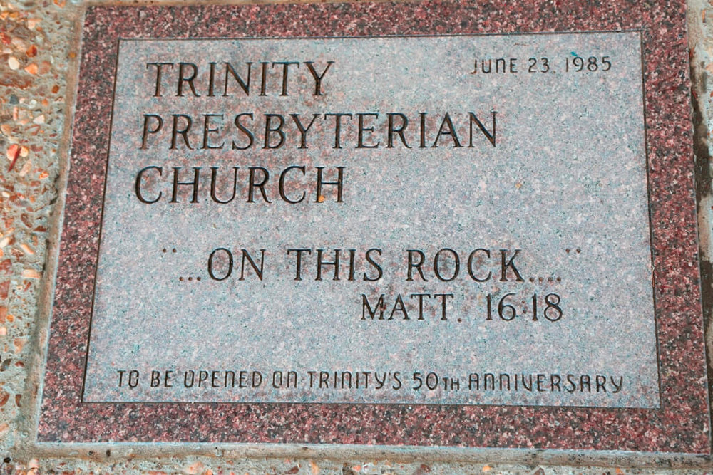 - Trinity's history is marked by a strong commitment to glorify God and serve the world.  With God's help, we have been able to develop a ministry that helps our members grow spiritually as we serve others. Our South Tulsa church first began meeting at Holland Hall School in 1981.  The first building was built on South Memorial Drive. It served the congregation well until a change in demographics and aging building made a new structure necessary.  The current sanctuary on 111th street between Memorial and Mingo contains many elements moved from the building on Memorial. The cross, communion table, and baptismal font were moved into the new church. The pulpit in the chancel and the font in the narthex were given to Trinity from our sister congregation, Second Presbyterian Church, Tulsa.