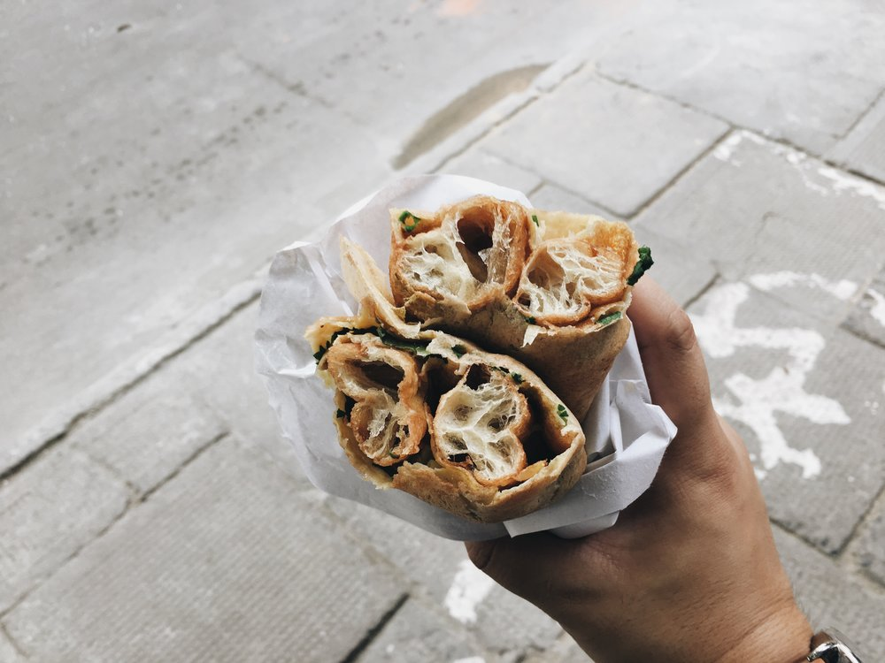 Dan Bing: One of my favourite breakfast foods in Shanghai. It's like a crepe with egg, chives and either youtiao or some crispy beancurd skin. Only SGD 0.80!