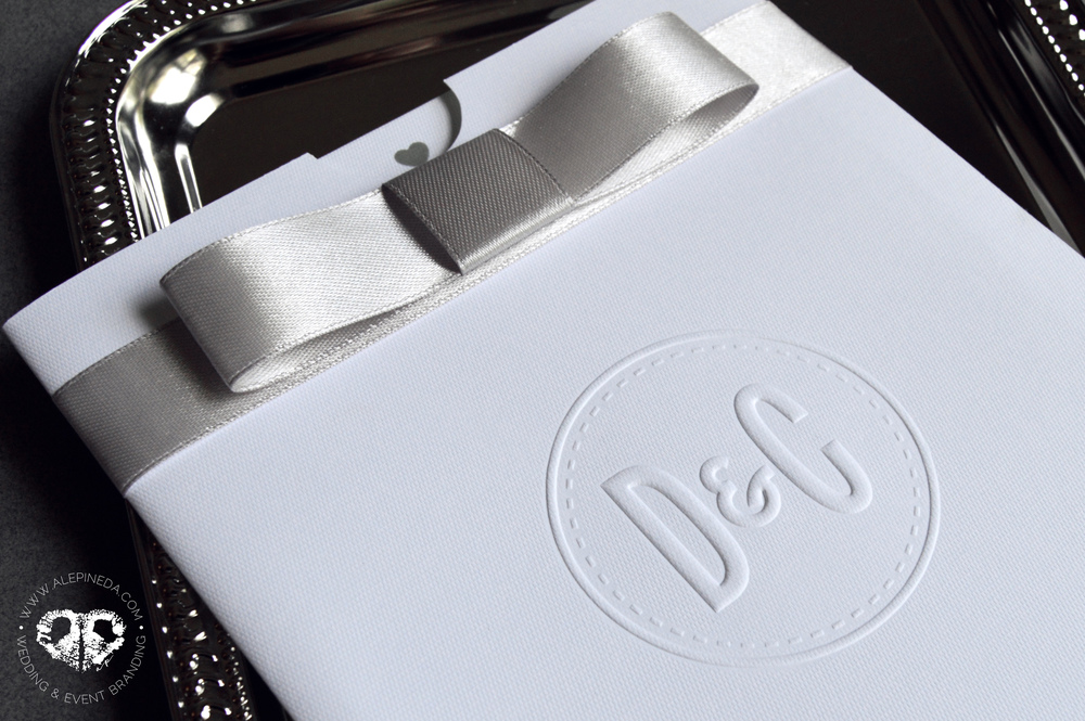 Contempo pocket sleeve invitation with embossed logo and grey ribbon