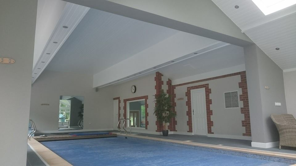 Swimming pool redecoration in Wanborough using Sandtex and Zinsser