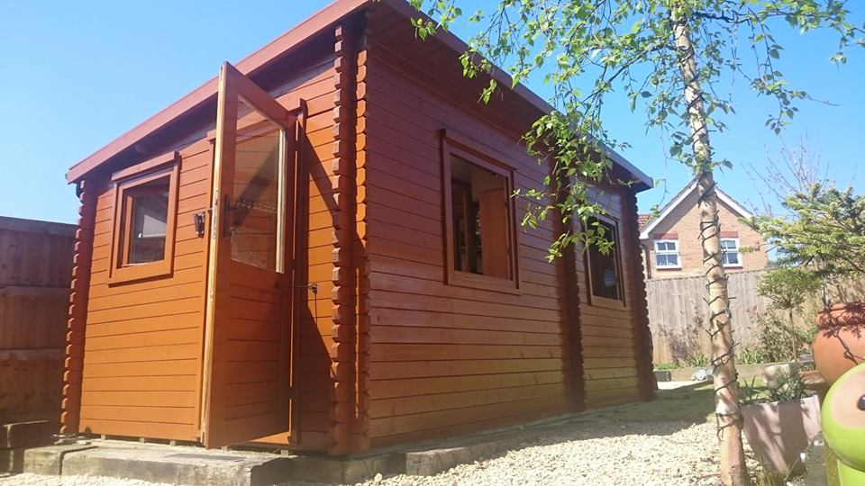 Exterior cabin decoration using Osmo oil in Swindon, Wiltshire