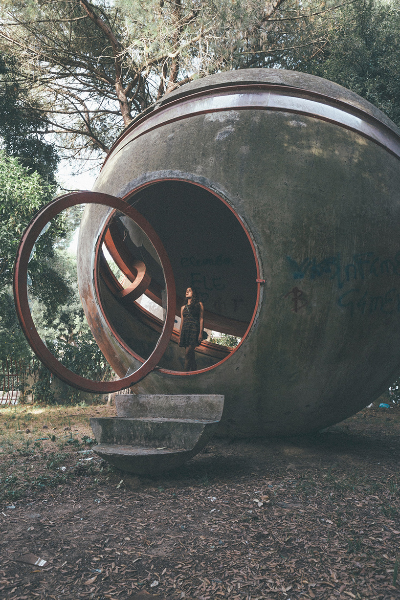 A spherical structure sits on site, with stairs leading up to a circular portal
