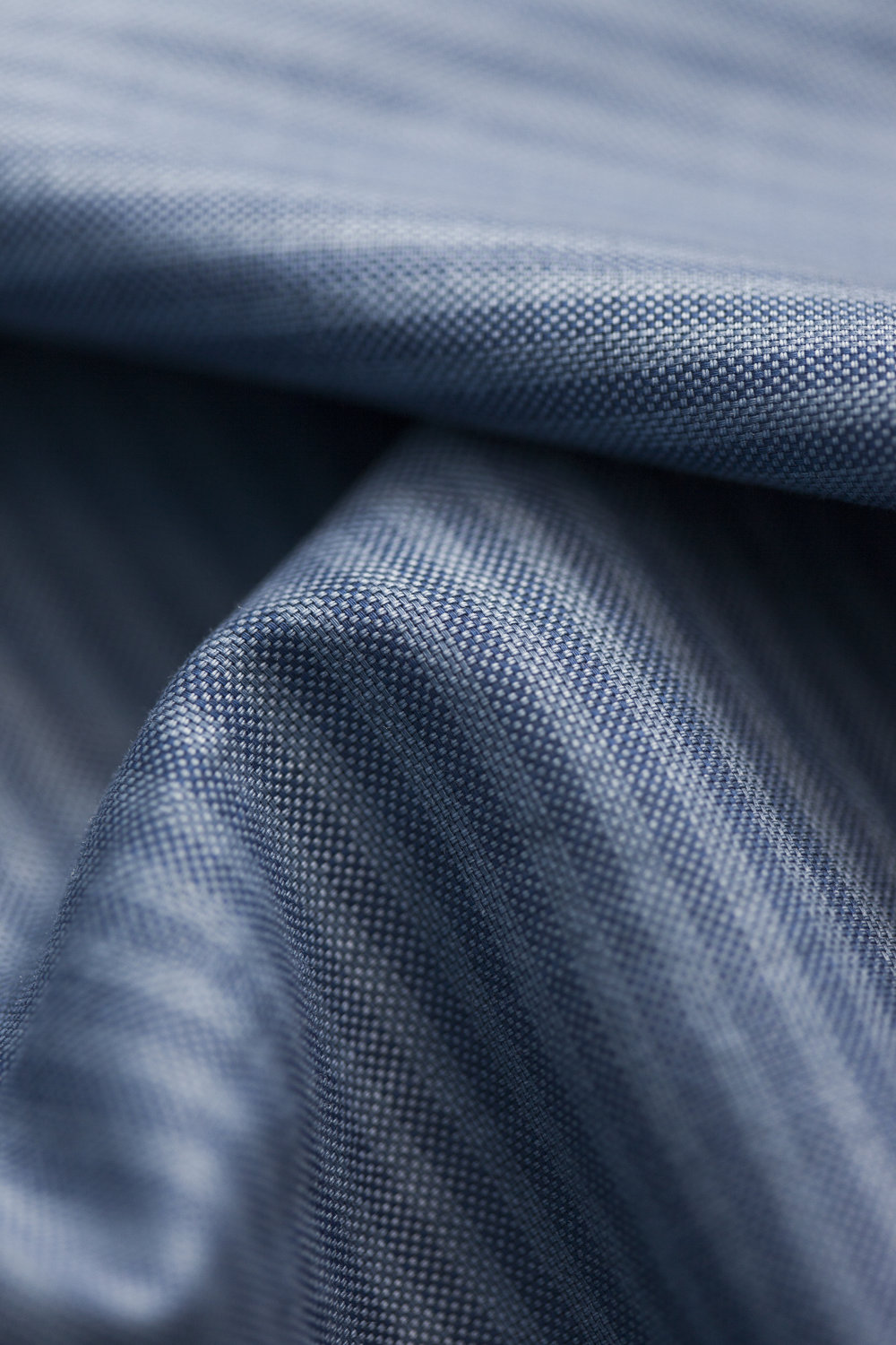 This striped oxford fabric has undergone a surface pigment printing as a final stage in the fabric process. This process gives a new cool look and by time a magnificent fade and tone out effect. The fabric is developed with our long term shirt fabric partner Tessitura Monti from Italy. Used on style Grit Stripe Shirt.