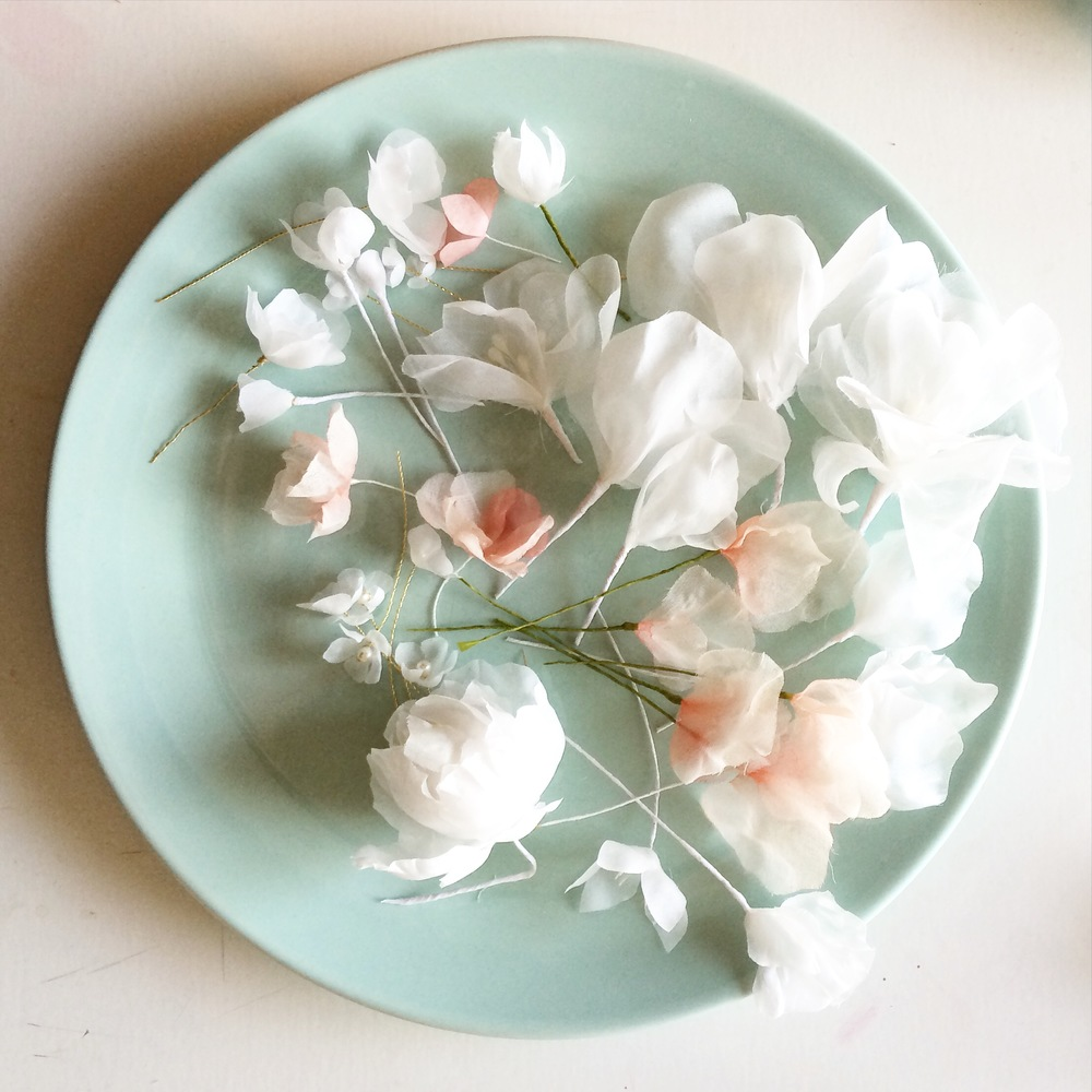 Handmade Silk Flowers waiting to be turned into samples for the new collection in blush, peach and white.