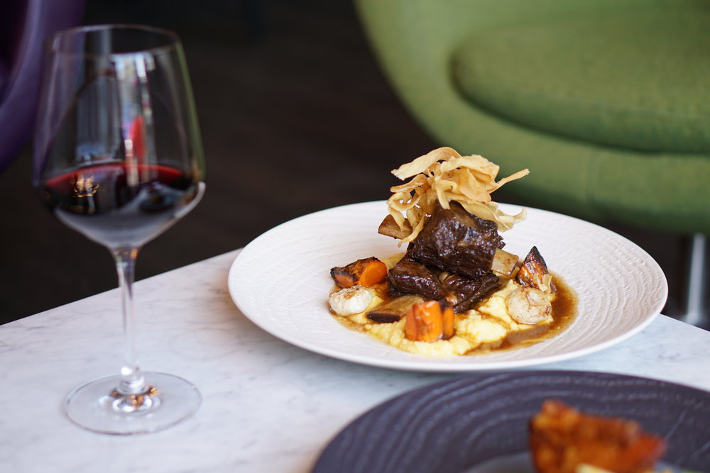Bison braised short rib, cheese polenta, crispy parsnips, roasted root vegetables