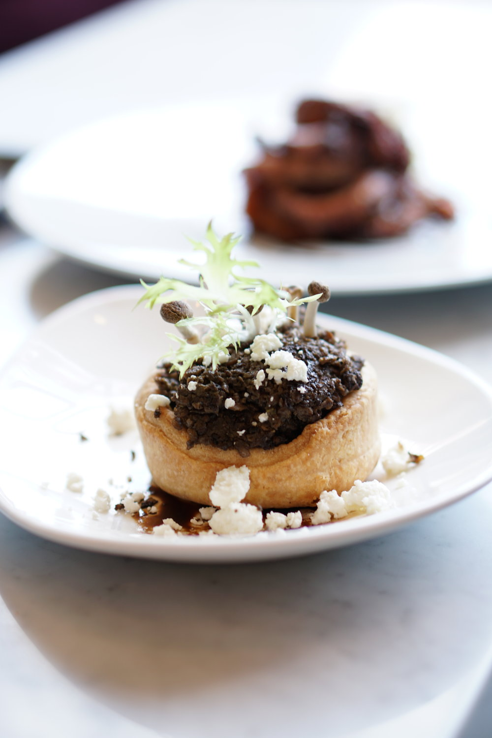 Mushrooms, balsamic, frisee, savoury tart shell, goat cheese
