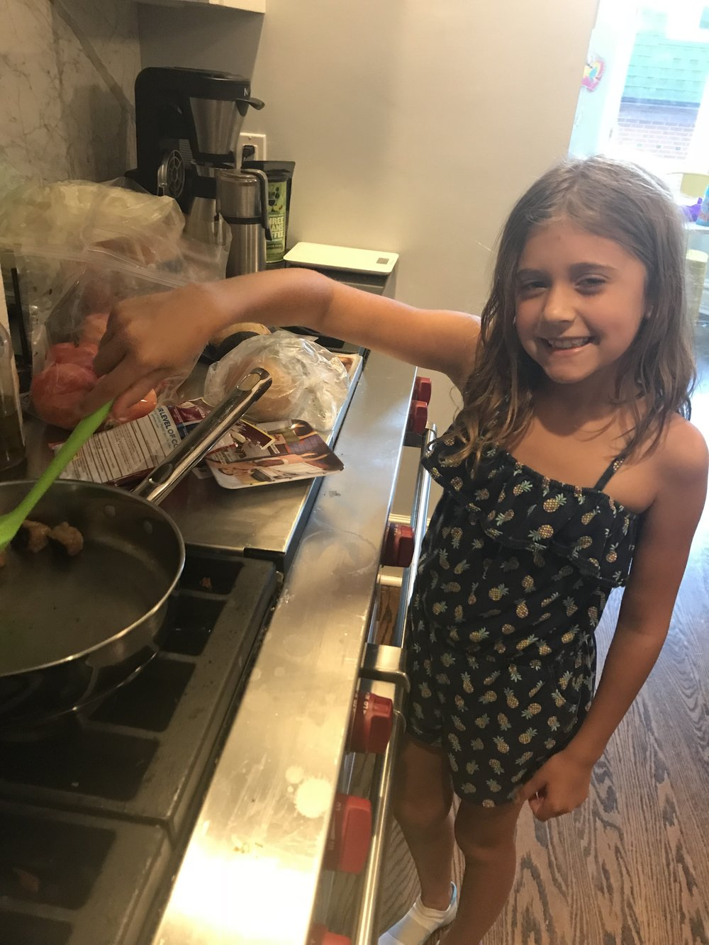 Miss E, cooking a vegetarian dinner.