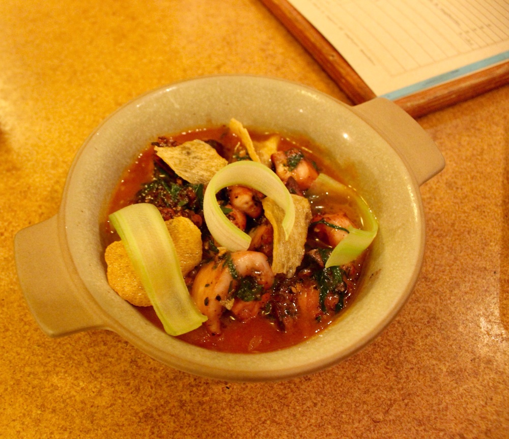 Charred Octopus with kampot peppercorn and tomato