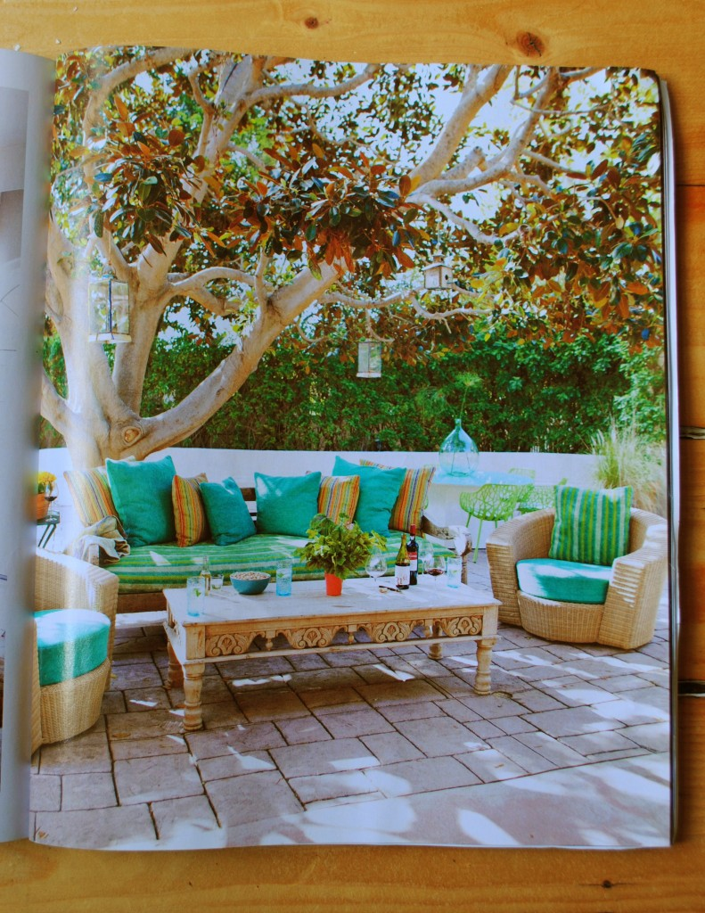 Bright aqua and blue textiles in an outdoor scene from the March issue of House Beautiful