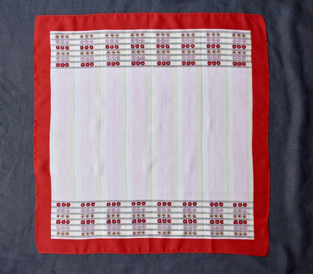 Floral scarf with a red border. Perfect for wearing or framing.