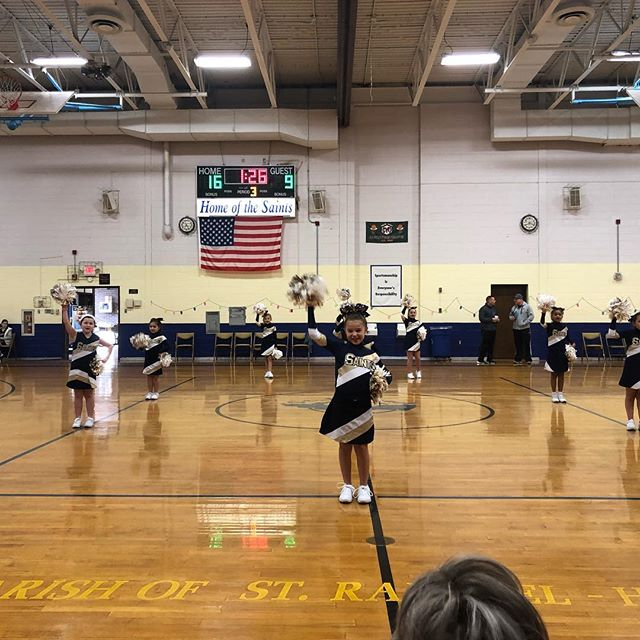 St. Raphael Cheerleaders cheering for Freshman boys Gold team