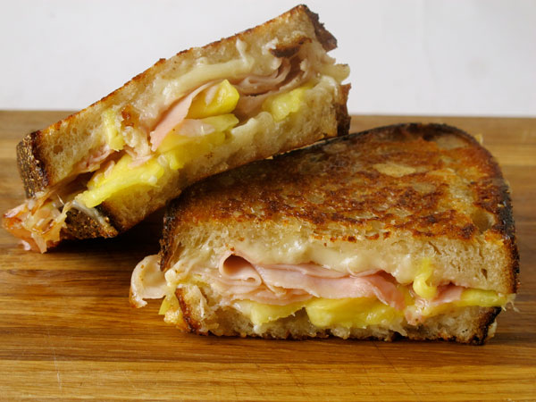Grilled cheese social's sandwich with pineapple, rosemary ham, comte and cultured butter