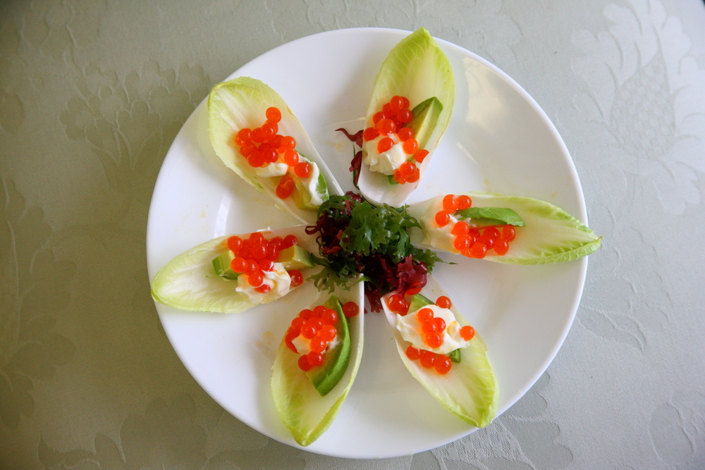 Cavi-Art  Caviar served endives topped with sour cream