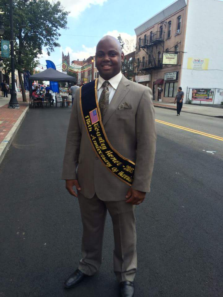 Jose Morillo, Country Honoree Dominician Republic Harrison Fest 2015 standing on Harrison Avenue closed to traffic on Saturday, September 19, 2015 after the Harrison 175th Anniversary Parade.