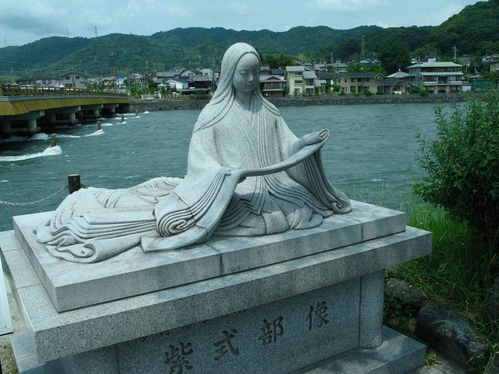 Statue of Murasaki Shikibu, author of Tale of Genji, perched over Uji river.