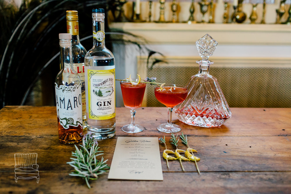Winter Glamour wedding photo shoot featuring Sara Galactica's Golden Hour cocktail: Featuring Chuckanut Bay Distillery gin, The Woods Spirit Co. Amaro, Lillet Blanc, lemon juice, and gilded lemon crescents on rosemary skewers. Details: http://www.saragalactica.com Photo: Katheryn Moran Photography