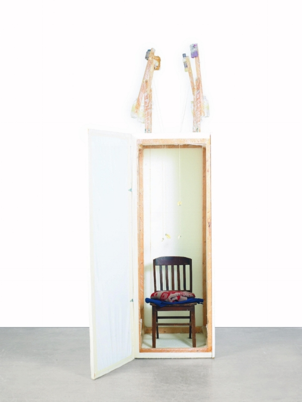 MOLKE-ME-MIND  styrofoam, wood, chair, sweater, pants, plastic bottles, vitamin pills, water, instant coffee powder, deodorant, mouthwash, string and tape 113 3/4 by 64 by 41 in. 288.9 by 162.5 by 104 cm. Executed in 1999.
