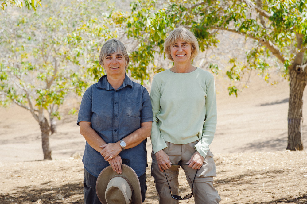 JUTTA THOERNER AND CYNTHIA DOUGLAS IN ONE OF THEIR WALNUT ORCHARDS. Photo courtesy of Manzanita Manor.