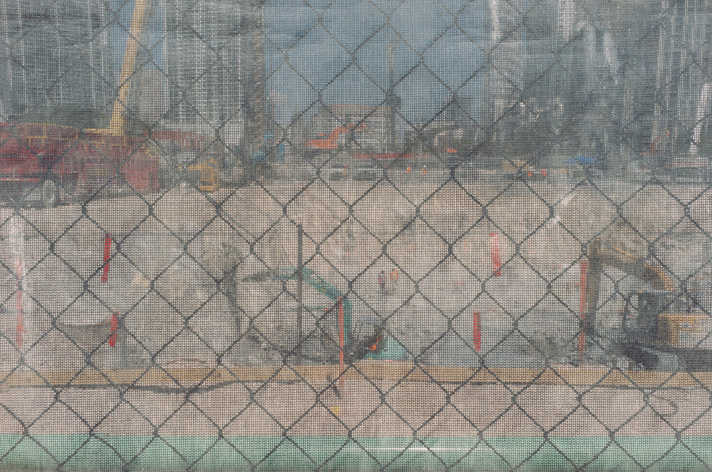 Workers in a construction site shot through a fence somewhere in Miami, FL - 2013