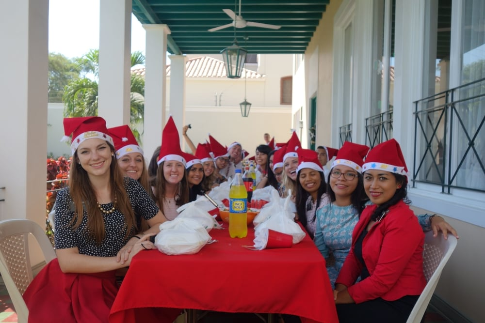 Everyone enjoyed the Christmas spirit, eating flamed broiled chicken, fries, and ice cold Inca Cola on a warm summer day.