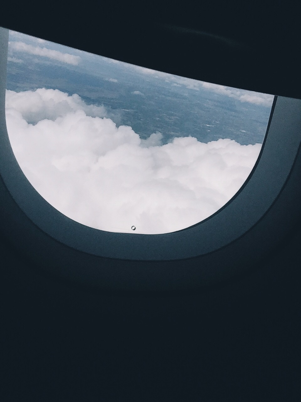 Clouds peeking through the window.