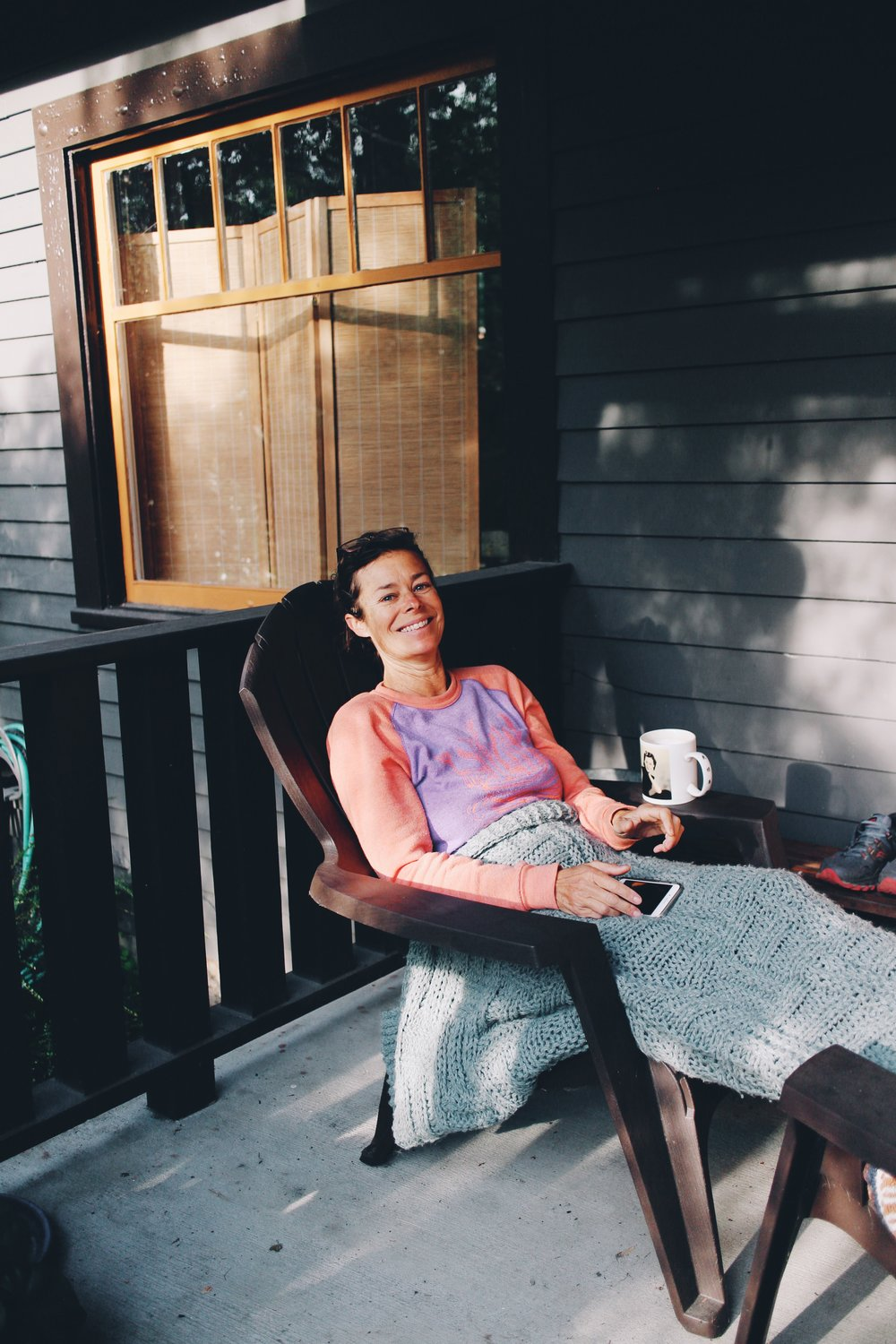 Eve enjoying her cup of tea on her porch in Portland.
