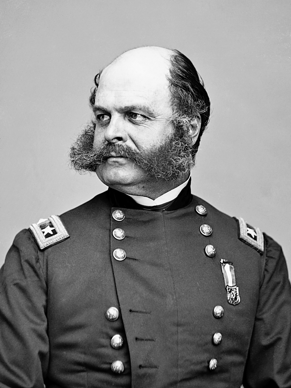 The Burnside: Also known as the Franz Josef, for the Austrian emperor. But we're giving the designation to Ambrose Burnside, since the man credited for inventing the sideburn also sported the style, and was born nearly 25 years before the other gentleman. Time to get: Six to nine months Worn by: Uh, we just told you that