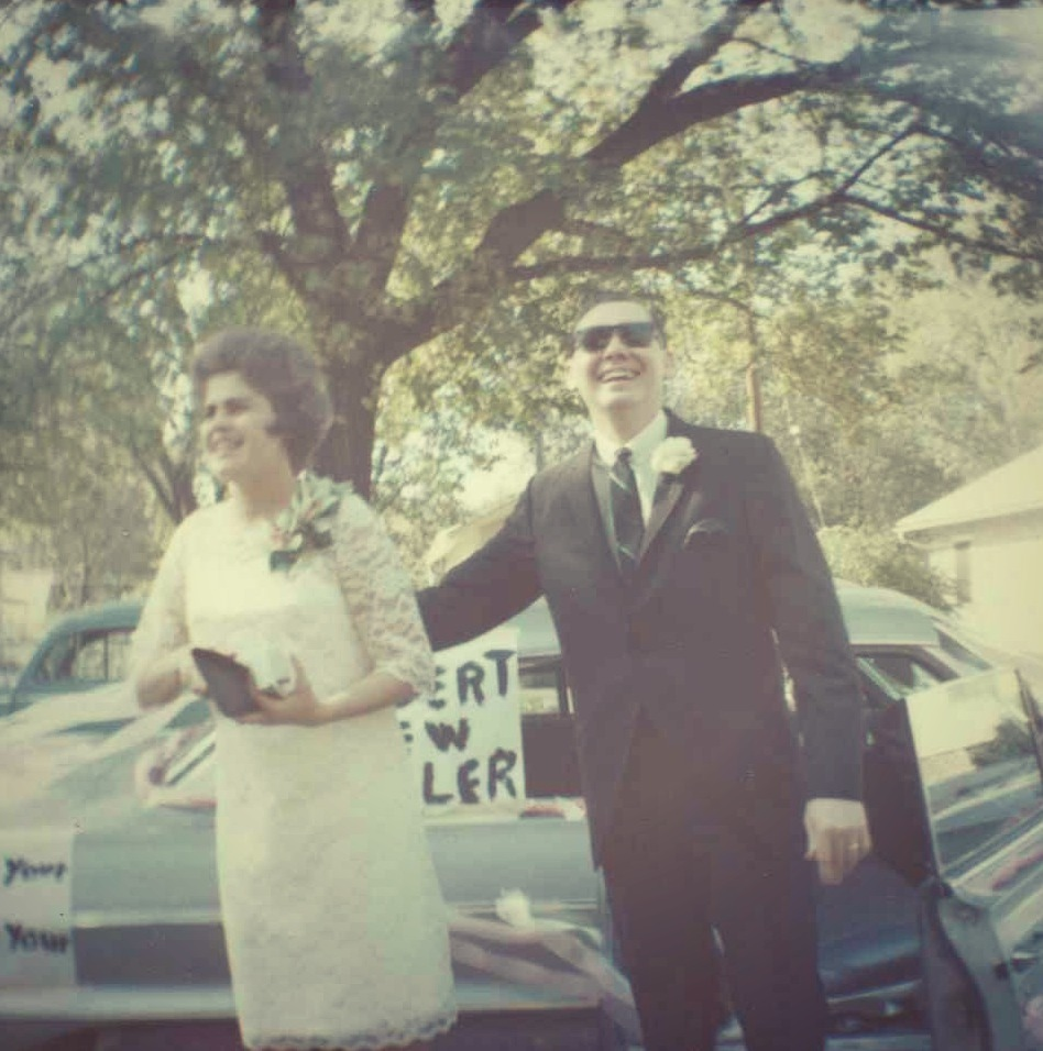 "My mother's second marriage and the sign on the car says ""New Dealer."""