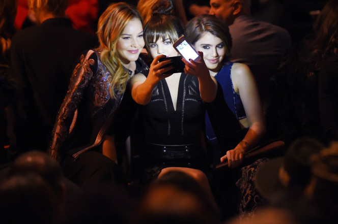 (From left) Actresses Abbie Cornish, Bailee Madison and Sami Gayle take a selfie as they attend BCBGMAXAZRIA Fall 2016 during New York Fashion Week on Feb. 11, 2016. (Getty Images)