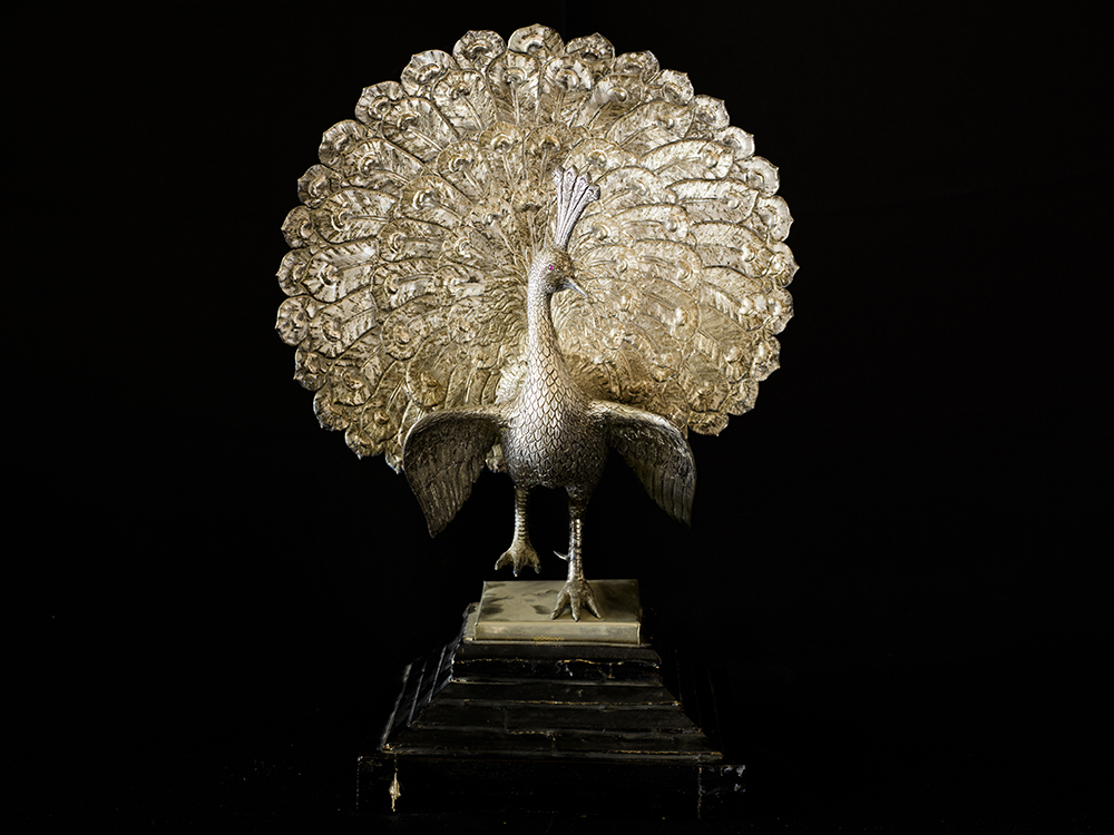 A Burmese Academy Award trophy dating from the 1950's. The peacock was the emblem of the Konbaung Dynasty; the last dynasty to rule Burma. It later became a symbol of Aung San Suu Kyi's pro-democracy movement, the NLD.