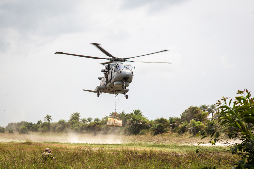 British Navy Helicopter delivers food aid