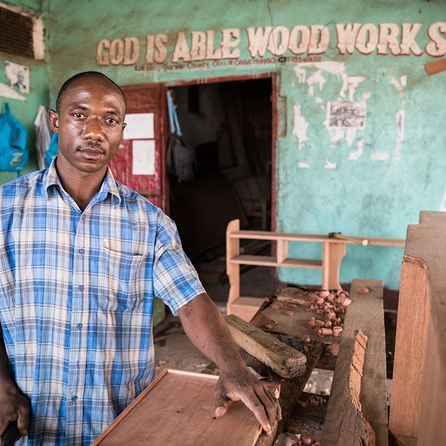 Amos Fallah is a carpenter and owner of the God Is Able Wood Work Shop in Kakata, Liberia. Amos recently completed training with #UNIDO learning how to work with more sustainable and locally sourced wood #UN #photography #liberia #kakata #westafrica #carpentry #woodworking #rubberwood #godisable #africa #craftmanship #locallyproduced #handmade @unido_newsroom @unitednations