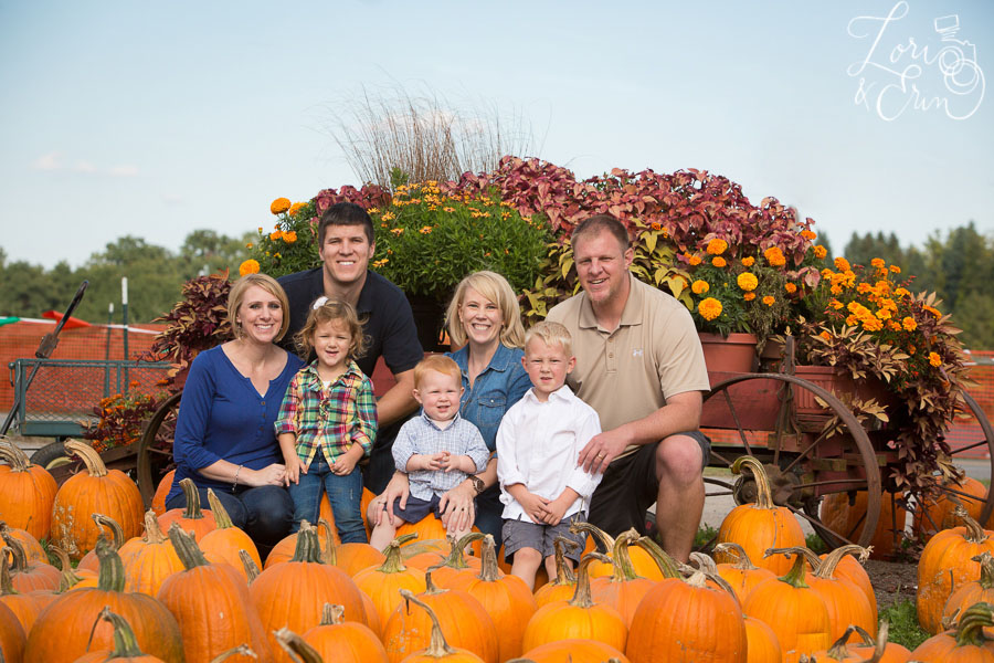 family by pumpkins