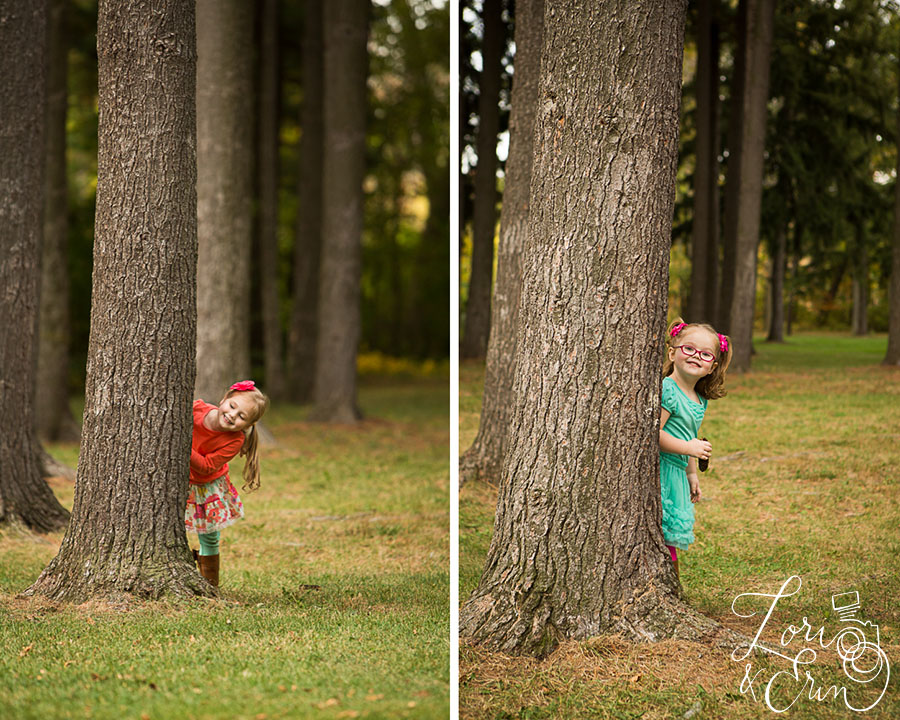 girls peeking behind tree