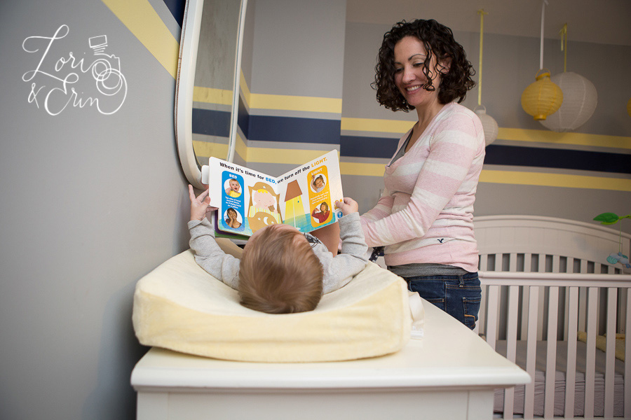 baby reading on changing table