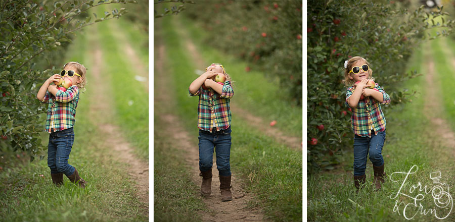 little girl carrying apples