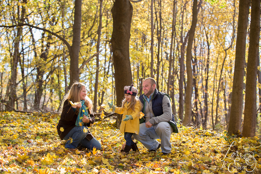 family catching leaves