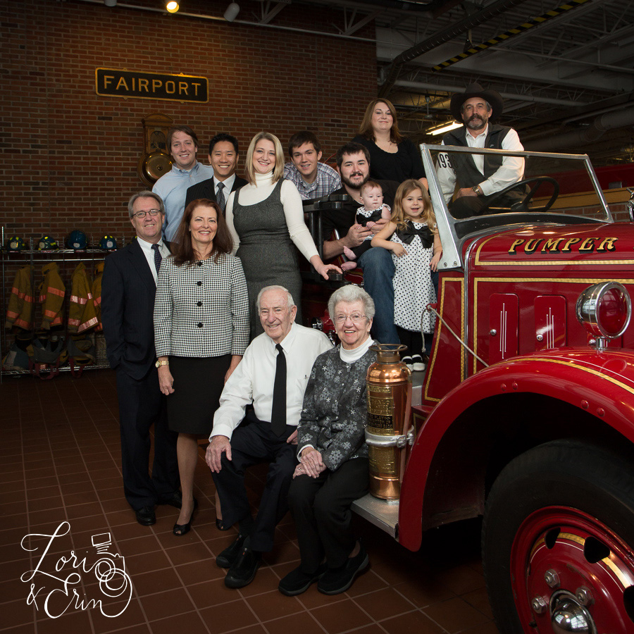 big family with fire truck