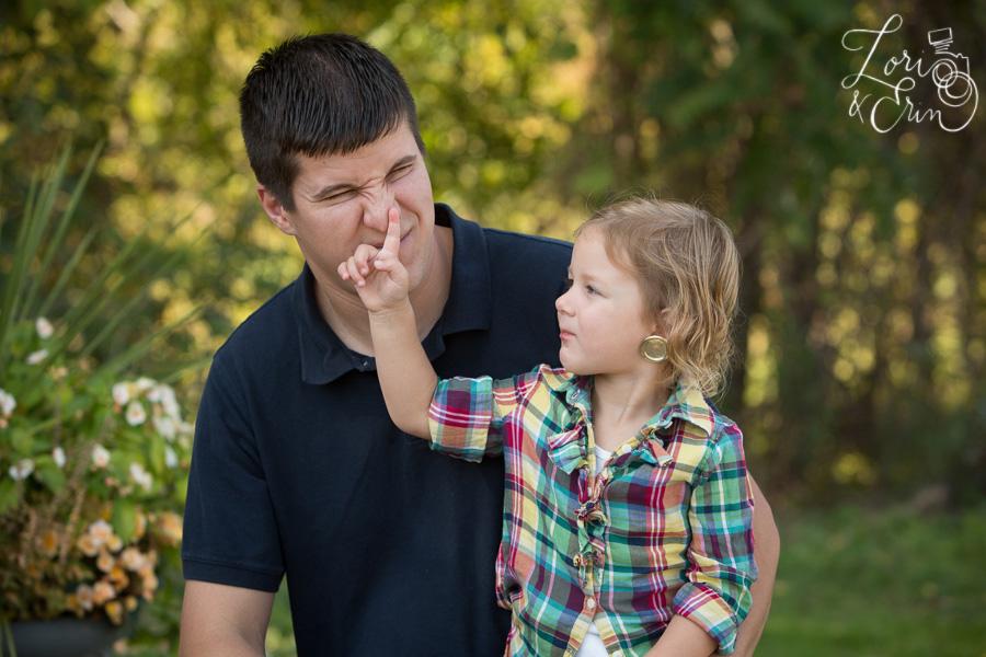 funny portrait picking nose