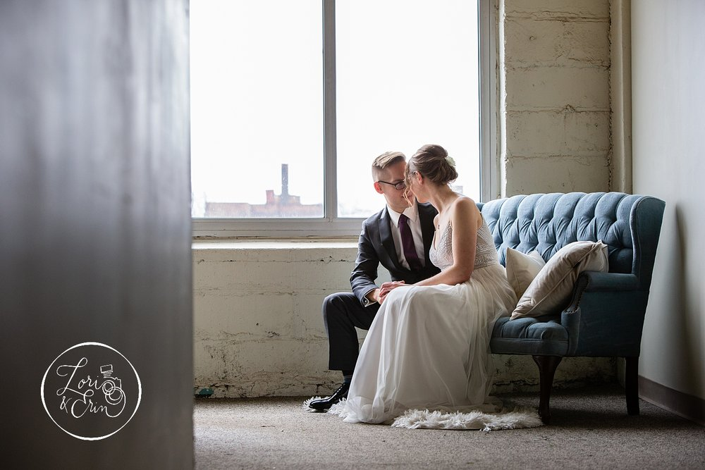 """I really loved everything about this photo - the angle with the wall, the white fluffy rug and blue couch, the city building in the background, and the texture of the wall - I just found everything about it to be beautiful and interesting."""