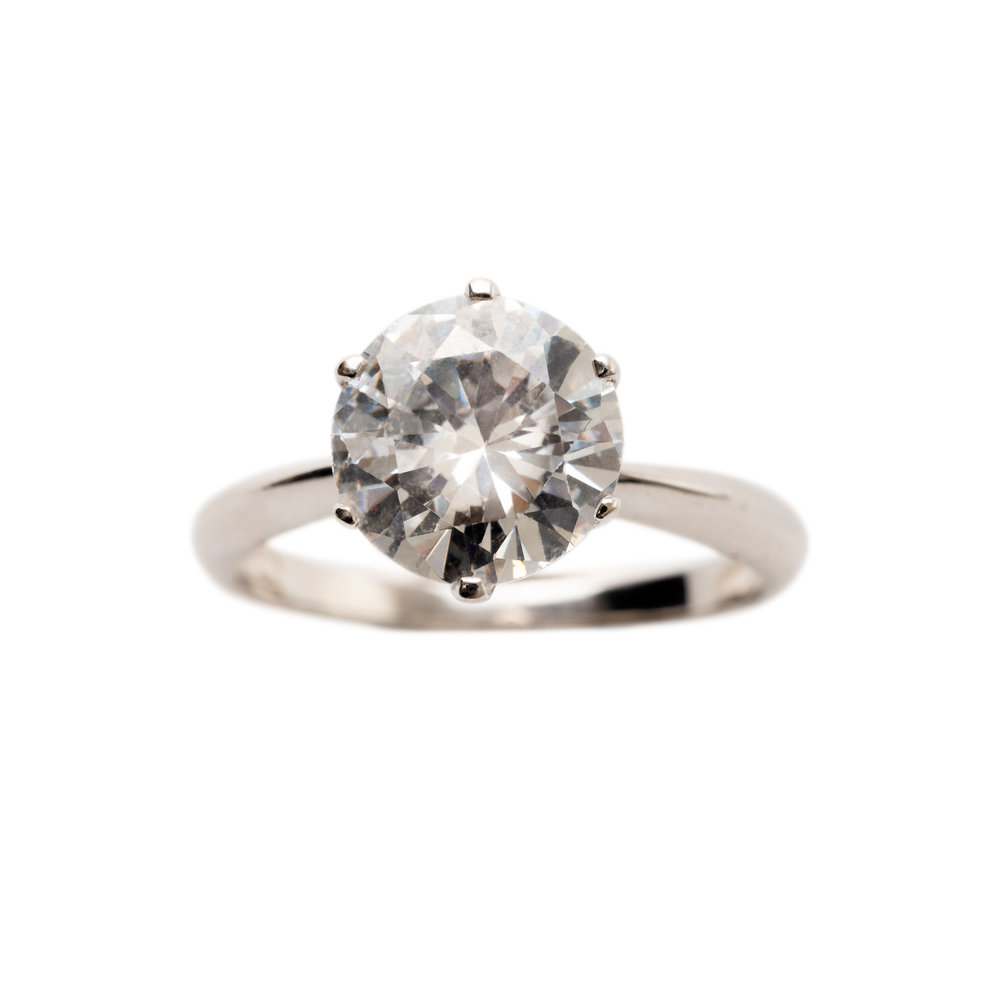 SOLITAIRE RING PRICE UPON REQUEST. 18 kt gold with 2 kt River diamond
