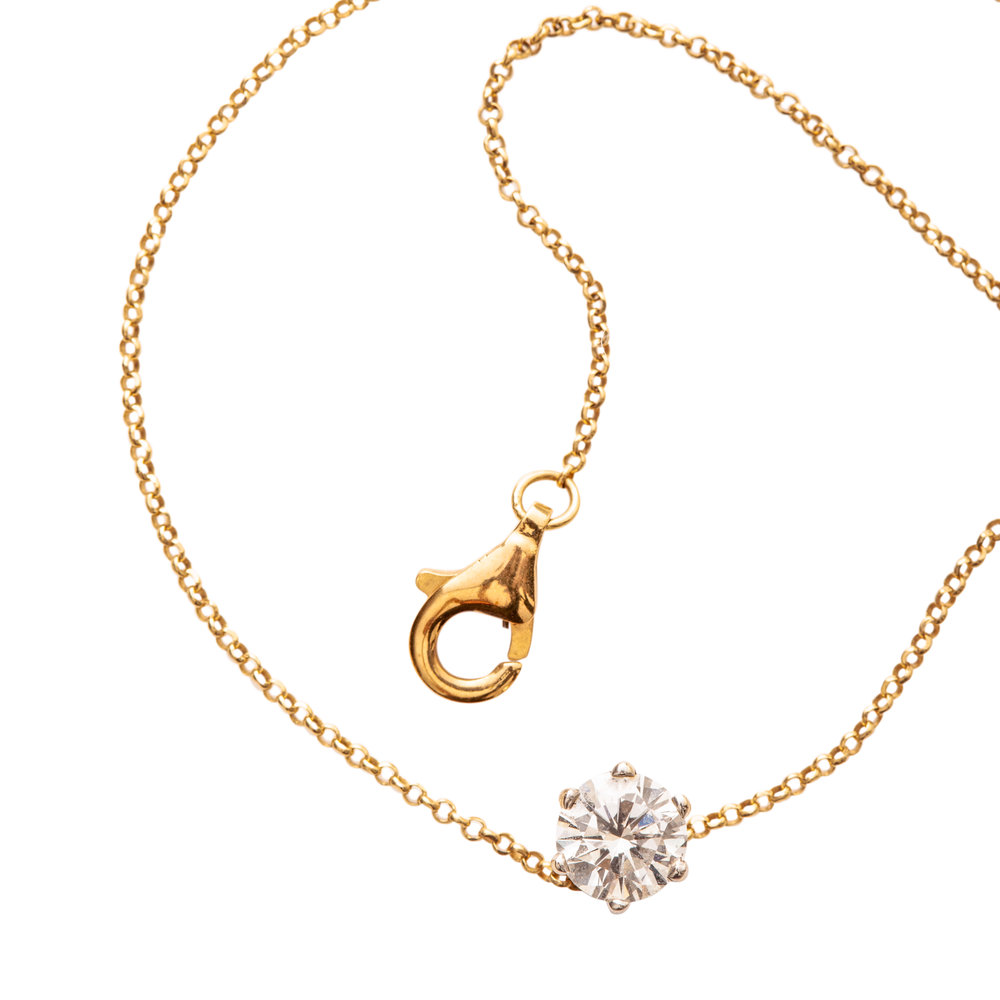 FLOATING DIAMOND NECKLACE PRICE UPON REQUEST   18 kt gold with 0,70 kt diamond