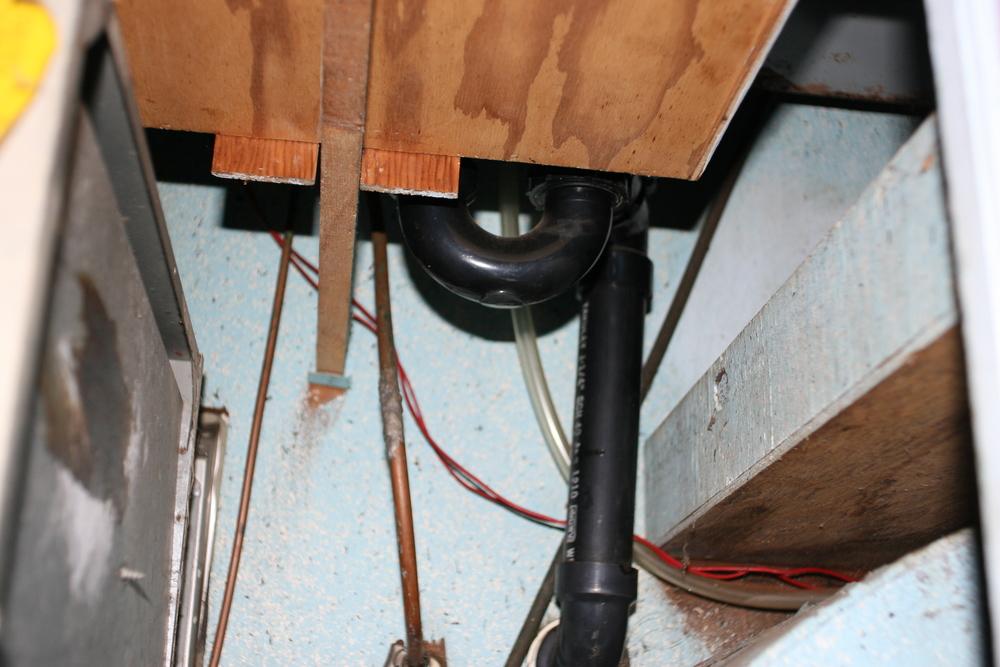 Under sink.