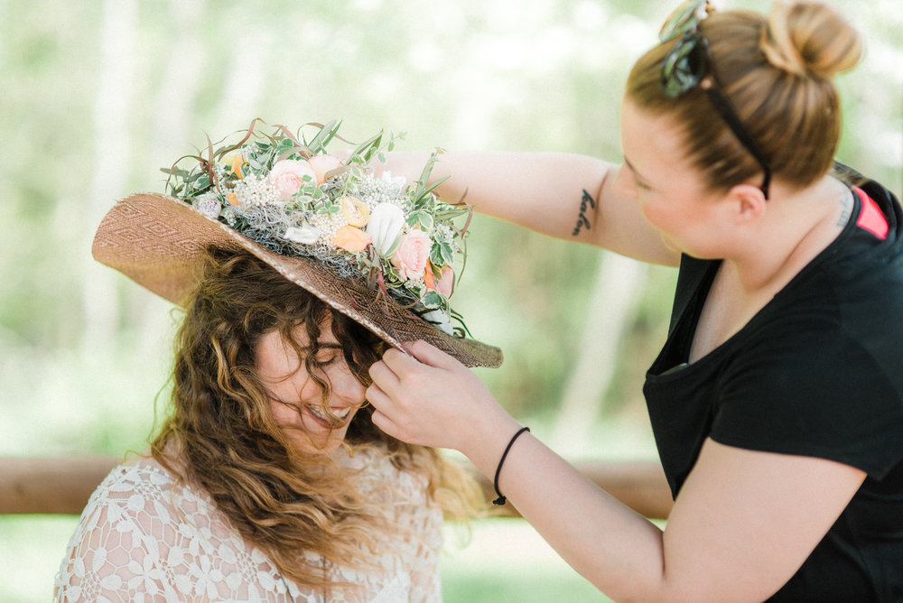 Sam  securing the masterpiece of a headpiece created by  greensinner